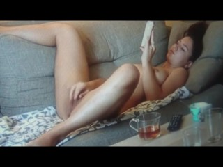 Sexy girl caught masturbating on couch comes twice!