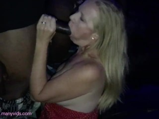 Slutwife sucking BBC at the porn theater