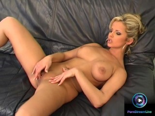 Danielle strips nude exposing her huge tits and fresh cunt