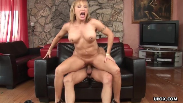 Pierced Milf gets a tasty mouthful from her young fucker