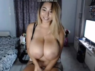 Selly Madelline plays with her huge boobs on Chaturbate
